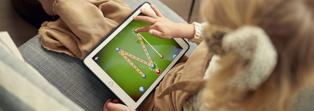 Girl playing Letterschool on iPad